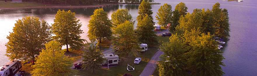 RV park from a distance, surrounded by water