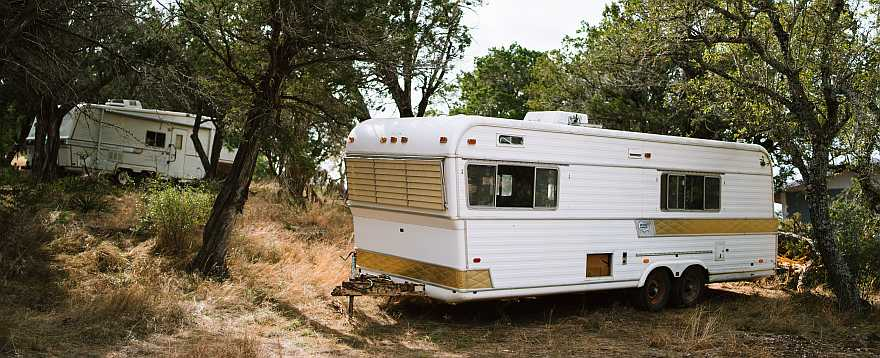 Older camper or trailer with faded paint