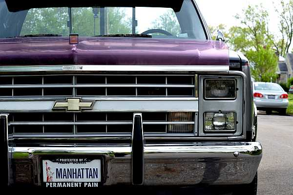 A Maroon colored Chevy 1500 truck